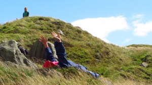 reclining participant in grass and heather